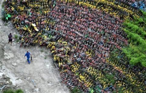 pict-中国が大量生産しまくった自転車の山7.jpg