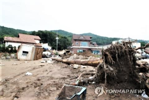 pict-豪雨で死者15人・不明11人に.jpg