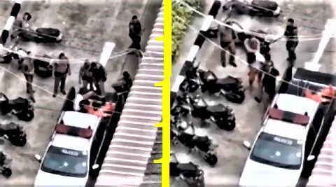 pict-Policemen beating suspect.jpg