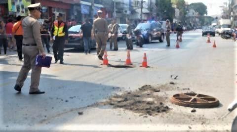 pict-manhole cover explodes.jpg